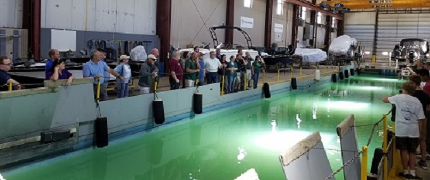 tech ed teachers observing student manufactured SeaPerch robots at Marquis Yachts